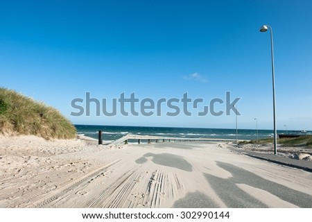 A road in Hirtshals covered with sand - stock photo