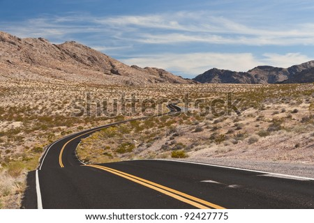 A road in the desert of Nevada, USA - stock photo