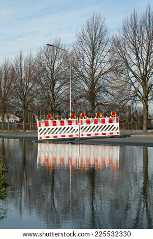 A road is closed because of flooding - stock photo