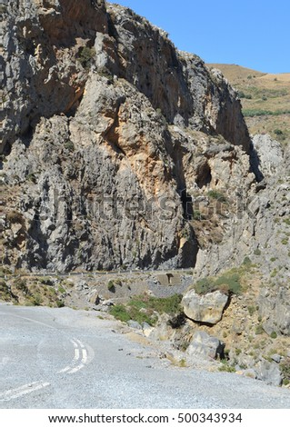 A road leading through the mountains in Crete