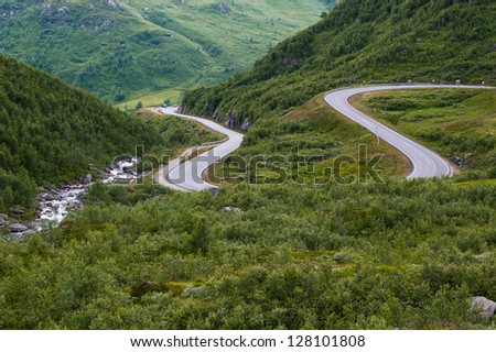 A road over one of the many mountains in Norway - stock photo