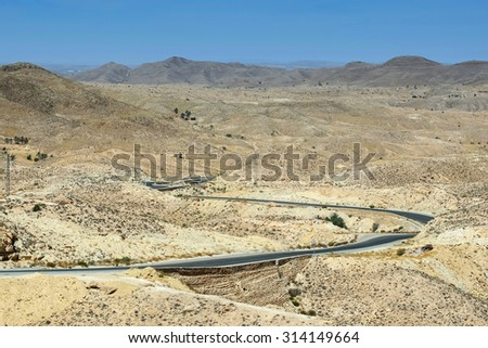 A road passing through the rocky Sahara desert in Matmata, Tunisia.