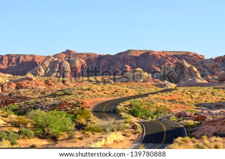 A road runs through it in the Valley of Fire State Park near Las Vegas Nevada - stock photo