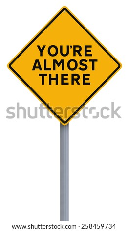 A road sign indicating You're Almost There  - stock photo