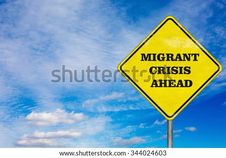 A road sign Migrant Crisis on a sky background