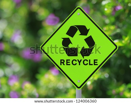 A road sign on recycling isolated on white - stock photo