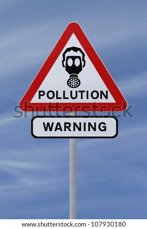 A road sign warning of pollution ahead (against a blue sky background)