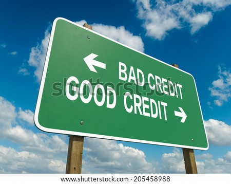 A road sign with bad credit good credit words on sky background  - stock photo