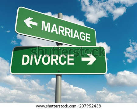 A road sign with marriage divorce words on sky background  - stock photo