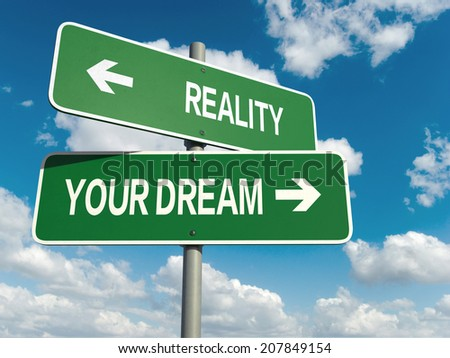 A road sign with reality dream words on sky background  - stock photo