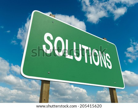 A road sign with solutions words on sky background  - stock photo