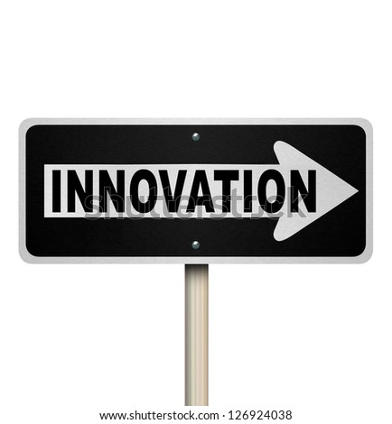 A road sign with the word Innovation pointing the way to innovative ideas, imagination and originality to solve your problem or challenge - stock photo