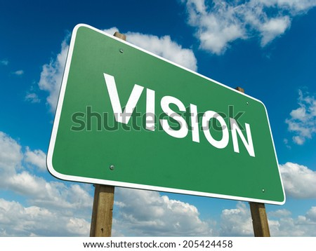 A road sign with vision words on sky background  - stock photo