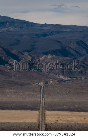 A road to Death Valley National Park, California, USA We drove pass desert, mountains, and salt flat to our destination. - stock photo