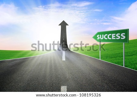 A road turning into an arrow rising upward with a road sign of success, symbolizing the direction to success