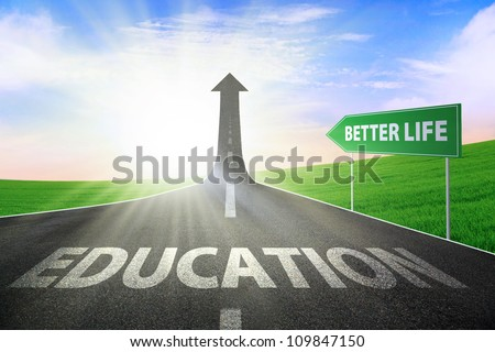 A road turning into an arrow rising upward with a text spelling out EDUCATION and signboard of better life, symbolizing the path to gain better life - stock photo