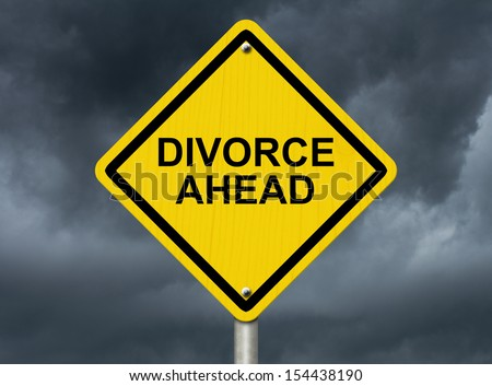 A road warning sign against a stormy sky with words Divorce Ahead, Warning of Divorce is soon - stock photo