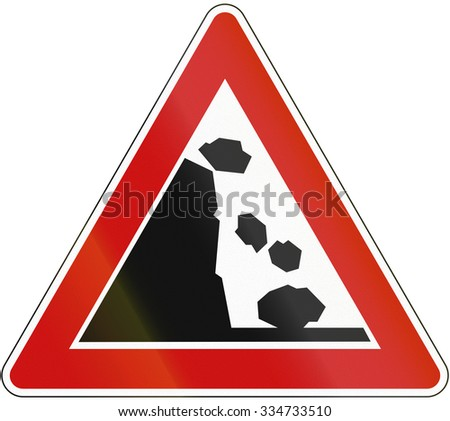 A road warning sign in Germany: Falling rocks from the left.