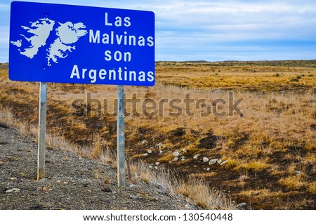 A roadside sign in Tierra del Fuego declaring that the Falklands Islands are Argentine. - stock photo