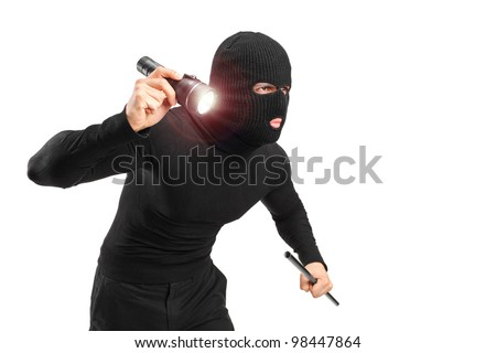 A robber with robbery mask holding a flashlight and piece of pipe isolated on white background - stock photo