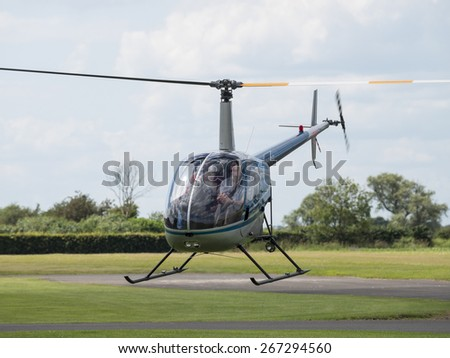 A Robinson R22 two seater pilot training helicopterat Breighton airfield,Yorkshire,UK.taken 14/07/2013 - stock photo