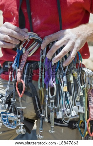 A rock climber organizes his equipment after a successful ascent.