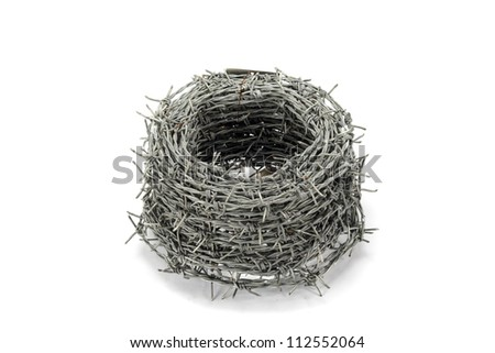 A roll of barbed wire on white background - stock photo