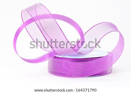 A roll of decorative florist purple ribbon - stock photo