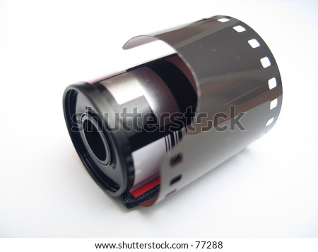a roll of film isolated on pure white background - stock photo