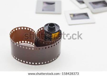 A roll of photographic film with slide mount frames
