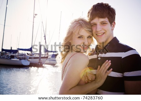 A romantic caucasian couple in love at the marina outdoor - stock photo