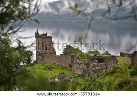 A romantic ruin of Urquhart Castle, Scotland - stock photo