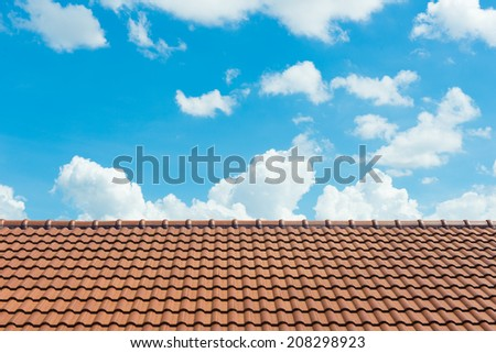 A Roof Top with Red Tiles.