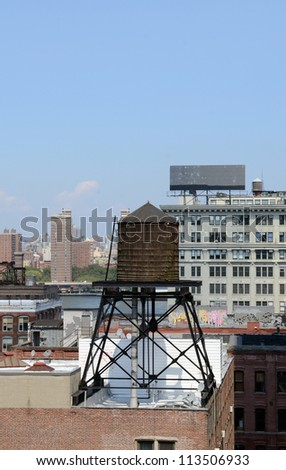 A Rooftop water tanks on a New York apartment building