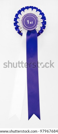 A rosette for 1st place with blue and white ribbon - stock photo
