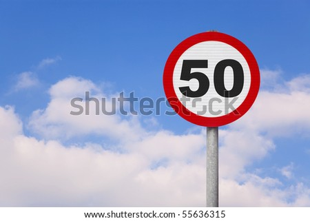 A round roadsign with the number 50 on it against a blue cloudy sky.