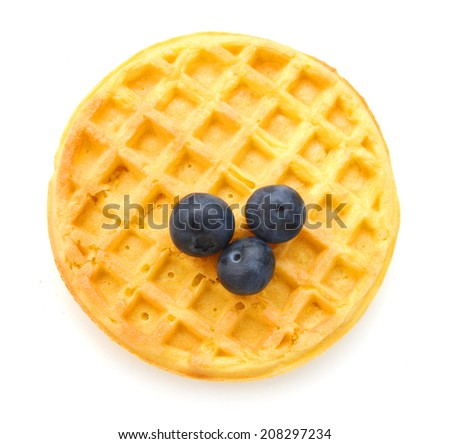 a round waffle and blue berries on a white background  - stock photo