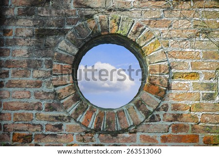 A round window where you see the sky - Freedom concept image - stock photo
