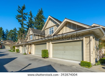 A row, lane of double doors garages in a nice and comfortable neighborhood. - stock photo