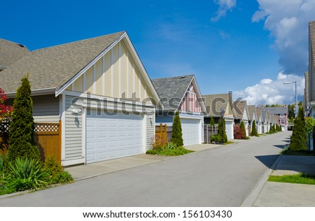 A row, line, perspective of double doors garages. North America.