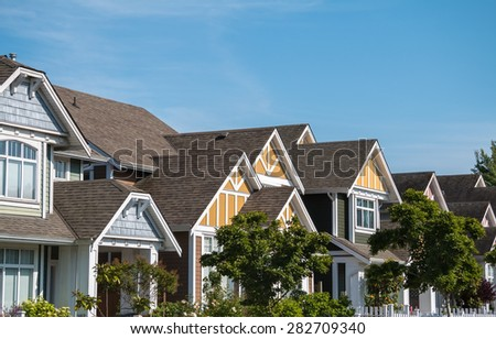 A row of a new houses in Richmond, British Columbia - stock photo