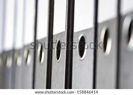 A Row of binders in an office archive, shallow depth of field - stock photo