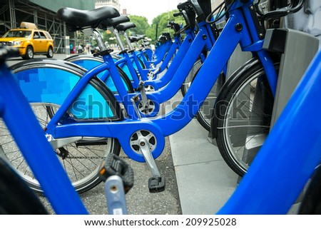 A row of blue bicycles on new york street - stock photo