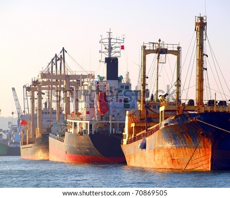 A row of cargo ships is anchored at Kaohsiung Port - stock photo