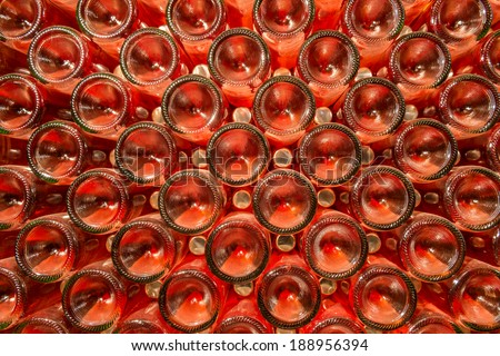 A row of champagne bottles - Wine cellar Bottles of wine stocked in a wine cellar. - stock photo