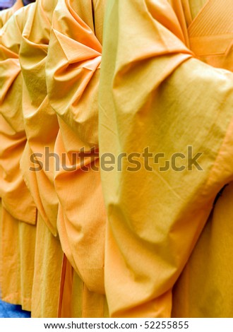 a row of Chinese buddhist monk , detail of robes. - stock photo