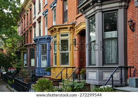 a row of colorful apartments in a big city - stock photo