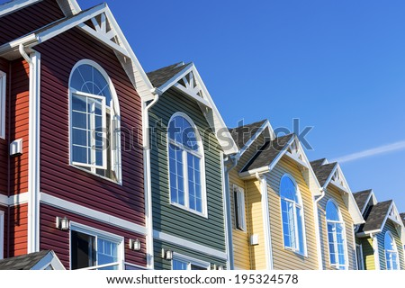 A row of colorful new townhouses or condominiums. - stock photo