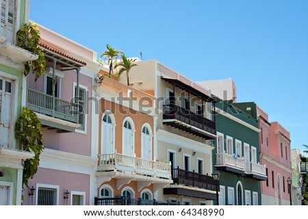 A row of colorful pastel painted buildings in Old San Juan Puerto Rico. - stock photo
