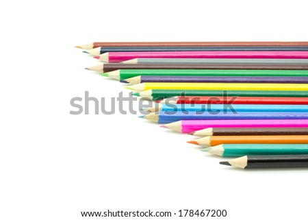 A row of colorful pencils on a white surface